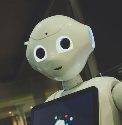 Photo of white robot named Pepper with humanistic features