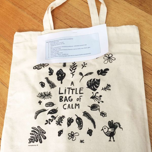Calico bag screen printed with floral design and the words A Little Bag of Calm