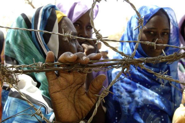 Photo of women behind a wire fence